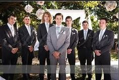 Groom in gray and groomsmen in black. Because the groom should stick out as well!
