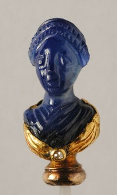 Roman Dress Pin  --  Carved from a single sapphire, gold  --  100-130 CE.