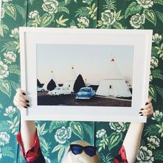 """I absolute adore the work of Portland-based photographer @kevinruss! His imagery is the base of my ever growing gallery, with this framed ""Teepee"" print as the newest addition! I love his documentary style of the West with subtle pops of color; it truly is my OKL obsession!"" - our samples coordinator @abigailcollinscampbell"