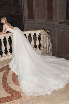 9a3b20fb1f3 For a glamorous fitted mermaid look our  Amani couture wedding gown is made  of delicately