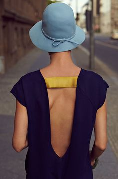 A bit flapper and a bit mod... A pale blue cloche hat and open back chemise...elegant day wear!!