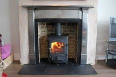Cast iron mantel - brick slips -slate tiled hearth - Clearview Pioneer 400 - multi fuel stove fitted by Scarlett fireplaces