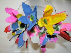 Celebrate Spring with an Egg Carton Craft for the kids! Erin of The Usual Mayhem shares how to make spring flowers with egg cartons on B-InspiredMama.com.