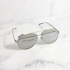 'Silver' Cool Cat Aviator Sunglasses Look cool with these suave aviator sunglasses featuring tonal bars above and below the lenses. With silver mirrored lenses in silver anodized metal hardware. Completed with slip-proof coated curves tips & 100% UV protected lenses.  Content & Care