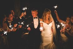 Bride and groom marking their wedding day with this stunning sparkler photo Wedding Suits, Our Wedding, Wedding Venues, Wedding Dresses, Civil Ceremony, Industrial Wedding, Wedding Wishes, Sparklers, Getting Married
