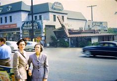 """Oh, this snapshot. How I love thee. Let me count the ways: We can see the legendary Schwab's Pharmacy and it's kooky neighbor, Googies Coffee Shop. I love the blur of 1950s car zooming down Sunset Blvd, and the fact this whole scene is in color. And those two women in the foreground, decked out in their days suits and hat. I wonder where they were going. I'm guessing they're off to a taping of """"Queen for a Day"""" at the old the Earl Carroll Theatre farther down Sunset."""