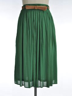 This green pleated skirt is wonderful for all year long! Pair it with a tucked in skirt to look fashionable at any event! It has pockets and comes with a brown belt. SKIRT HAS LINING 100% RAYON