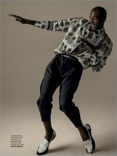 Busting a move, Ed Saldanha wears a jazz-inspired look from Dolce & Gabbana.