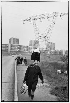 H Cartier-Bresson 1969 Essonne department. Portuguese returning to their slum district of Massy