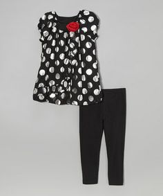 Fun-loving girls set the stage for a day of adventure when they rock this set! A rosette-trimmed neckline and sweep of asymmetrical ruffles make the polka-dot tunic pop, while leggings round out the look in soft, stretchy comfort.