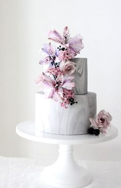 Unique two tier purple and pink lily wedding cake; Featured Cake: Winifred Kristé Cake