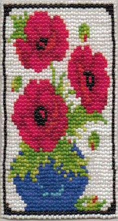 I had a little cross stitch kit that I decided to  bead the pattern.  Size 11 seed beads.