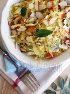 "YUMMY! ""Lightly sauteed cabbage with sweet onions and almond. A pretty cool recipe for a pretty non exciting vegetable."" I used basil as my herb of choice and substituted a tsp of Sriracha for the peppers. A pleasant hint of spice and very good!"