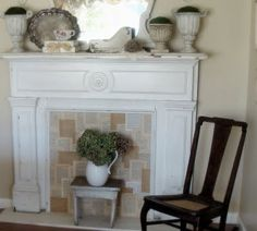 Ideas for using the fireplace surround that we have in our inventory -- like the idea of filling it with book pages.