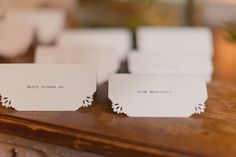 Super simple and really pretty place cards - corner punches from a craft store used on pretty paper
