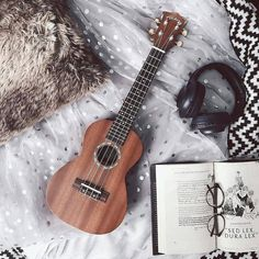 The ukulele is a very small guitar that originated from an island in Portugal called Madeira. In travelers took a ship from the island of Madeira to Hawaii.