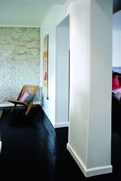 Brick wall with black floor