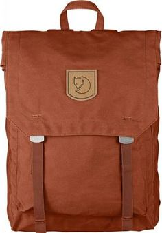0cac3a164b3 Unembellished backpack with a simple and functional design where the top  can be folded down and attached to the front with textile straps and metal  buckles.