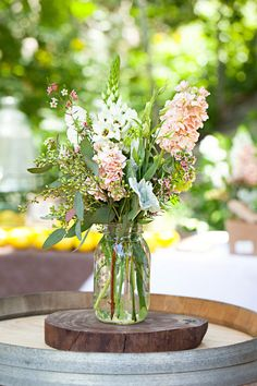Rustic Chic: Laid-back Rustic Wedding Theme Mason Jar Centerpieces, Rustic Wedding Centerpieces, Floral Centerpieces, Floral Arrangements, Wildflower Centerpieces, Mason Jars, Jam Jar Flowers, Wild Flowers, Table Flowers