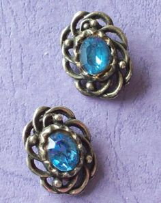 Vintage 1970s Clip on Earrings Blue Stone Framed in Pewter Fretwork by vintageretrojewels on Etsy
