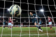 Eden Hazard Photos - Eden Hazard of Chelsea turns away to celebrate after scoring the opening goal during the Barclays Premier League match between West Ham and Chelsea at the Boleyn Ground on March 4, 2015 in London, England. - West Ham United v Chelsea