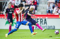 Neymar of FC Barcelona duels for the ball with Jorge Mere of Real Sporting de Gijon during the La Liga match between Real Sporting de Gijon and FC Barcelona at Estadio El Molinon on September 24, 2016 in Gijon, Spain.