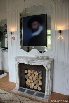 marble fireplace with mirror and artwork - San Francisco Decorator Showcase