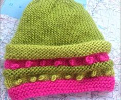 Another variation of Lynn Wilson's cute bobble baby hat, again using 'Sheepish' acrylic/wool yarn by Vickie Howell for Caron. Now hunting for a cute baby/toddler thumbless mitten pattern to knit a coordinating set.