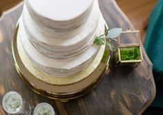 Modern white wedding cake / white wedding cake with greenery / simple design for a wedding cake | WeddingDay Magazine