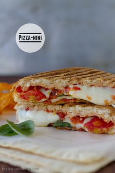 It's a pizza panini! This panini recipe has a homemade tomato sauce that is combined with cheese and pepperoni and grilled inside a sandwich for an easy meal both sandwich and pizza lovers will enjoy. The Best Homemade Pizza Dough Recipe, Homemade Pizza Rolls, Ray's Pizza, Lunch Box Bento, Rachel Ray Recipes, Panini Recipes, Panini Sandwiches, Good Food, Yummy Food