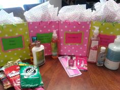 "Baby Shower Prize Bags:  ""Sweet Victory"" has candy, ""Our Shower to Yours"" has shower gel, body lotion & body spray, ""You Nailed It"" has nail files, polish & toe/fingernail clippers and finally, ""Give Yourself a Hand"" has hand lotion, hand soap & hand sanitizer."