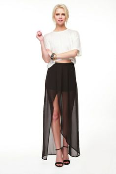 Freedom Black Wrap Maxi Skirt Tulip style maxi wrap skirt featuring pleating details at front. Invisible zipper closure at back. Partially lined. Lightweight. $17.99