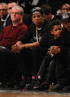 Jay-Z wearing Justdon Snakeskin Snapback and Nike Air Force 180