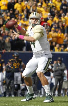 Bryce Petty #14 of the Baylor Bears drops back to pass in the first half against the West Virginia Mountaineers during the game on October 18, 2014 at Mountaineer Field in Morgantown, West Virginia.