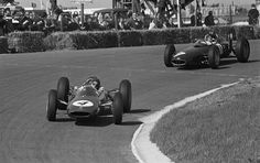 1962 Dutch GP, Zandvoort : Jim Clark (Lotus 25) is chased by the winner Graham Hill (BRM P57). (ph: © Bilsen, Joop van)