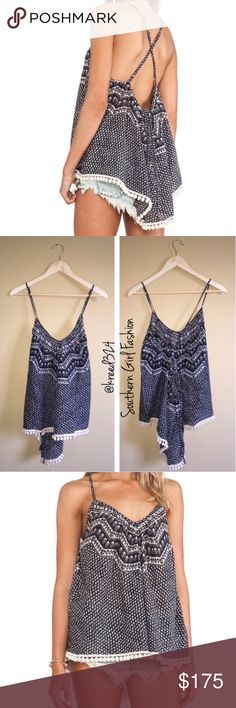 ETERNAL SUNSHINE CREATIONS Top Strappy Boho Swing Available Women's Sizes: XS/S, M/L.  New With Tags. $140 Retail + Tax.   - Light, airy and effortless, this strappy tank will be your new favorite summer essential. - Features an all-over geometric print and pom pom trimming at bottom high-low hem. - Straps are adjustable. - Unlined, semi-sheer.  Cotton. Imported.    ❗️ No trades, holds.    Bundle 2+ items for a 20% discount!   ✔️ Items are priced to sell, however reasonable offers will…