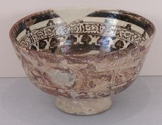 Bowl Date: 12th century Geography: Syria, Raqqa Culture: Islamic Medium: Stonepaste; painted in luster and blue on opaque white glaze under transparent colorless glaze