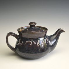 Teapot in stoneware clay