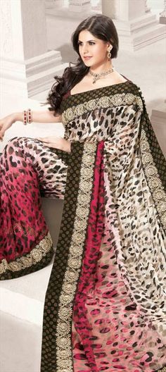 Code-76065  From strong leopard prints to cute cats prints, they all look beautiful in outfits. Lets make it more lively by adding colors to these prints. Cat prints when mixed with strong color make a different impact.  #leopardprint #animalprint #catprint #saree