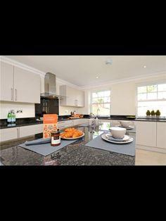 White kitchen cupboards with black worktop