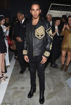 A winning formula: Lewis Hamilton rocked a pair of black ripped jeans and a heavily-embroidered leather jacket as he attended Balmain's H&M fashion showcase in New York City on Tuesday evening