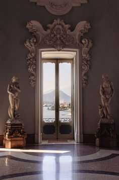 French doors with Baroque pediment and wonderful statues