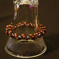 A wonderful Goldstone and Black bead bracelet adds a little sparkle to your day.   Bracelet measures 7 1/4 inches.