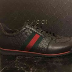 Authentic Mens Gucci sneakers Brand new, never worn. Chocolate brown micro guccissima leather w/ traditional webbing on sides. Men's size 8.5 Gucci Shoes Sneakers