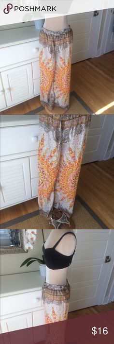 Beautiful Boho print Palazzo Pants Beautiful fully lined palazzo pants.Inseam 30.Size is S/M.Elastic waist, drawstring tie.Very good condition. Bhag's Boho Pants