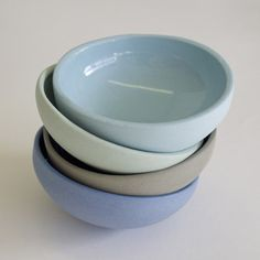 Set of 4 small bowls great for soy sauce. Handmade in a stoneware ceramic. Choose from 4 tinted clay colors with clear glaze or a mix.