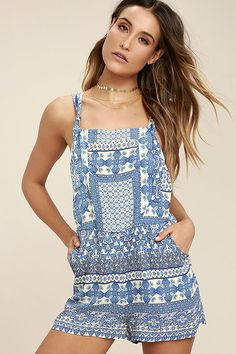 Pair the Patrons of Peace Tristan Blue Print Overalls with all of your favorite crop tops and tees! Festive blue, cream, and brown print woven fabric is formed to tying, adjustable straps, and a relaxed bodice with low scoop back, and snap button bib pocket. Shorts have front diagonal pockets.
