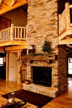 I love everything about this, from the balconies to the fireplace, to the wood, to the pillar, to the stones, etc