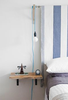What about something like this for night stands on either side of the bed? DIY floating shelf/nightstand
