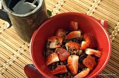 Chocolate Quinoa Porridge 1/3 cup Quinoa Flakes 1/2 tablespoon cocoa powder or cacao powder 3/4 cup water 1 teaspoon vanilla 1 tablespoon dried cherries 1 tablespoon sunflower seeds 1 tablespoon maple syrup 1/2 tablespoon coca nibs or chocolate chips 1/2 cup sliced strawberries